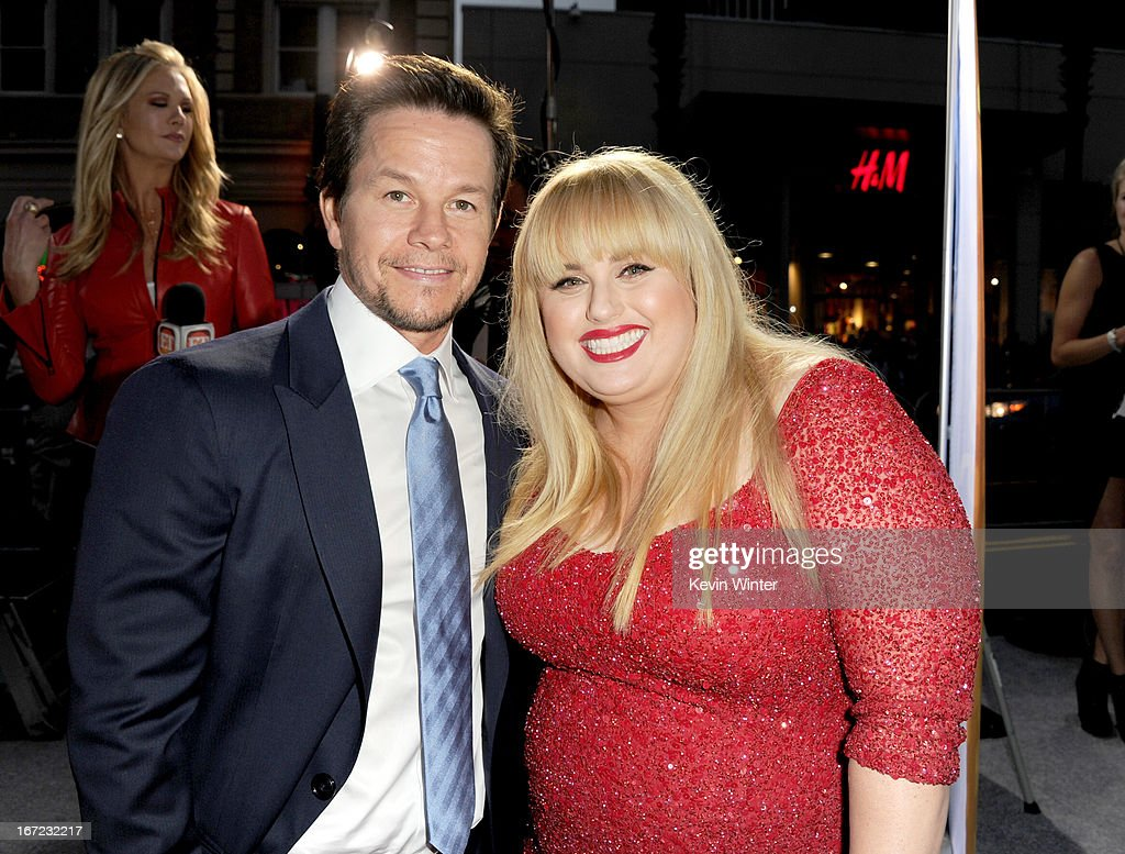 Actors <a gi-track='captionPersonalityLinkClicked' href=/galleries/search?phrase=Mark+Wahlberg&family=editorial&specificpeople=202265 ng-click='$event.stopPropagation()'>Mark Wahlberg</a> (L) and <a gi-track='captionPersonalityLinkClicked' href=/galleries/search?phrase=Rebel+Wilson&family=editorial&specificpeople=5563104 ng-click='$event.stopPropagation()'>Rebel Wilson</a> arrive at the premiere of Paramount Pictures' 'Pain & Gain' at TCL Chinese Theatre on April 22, 2013 in Hollywood, California.