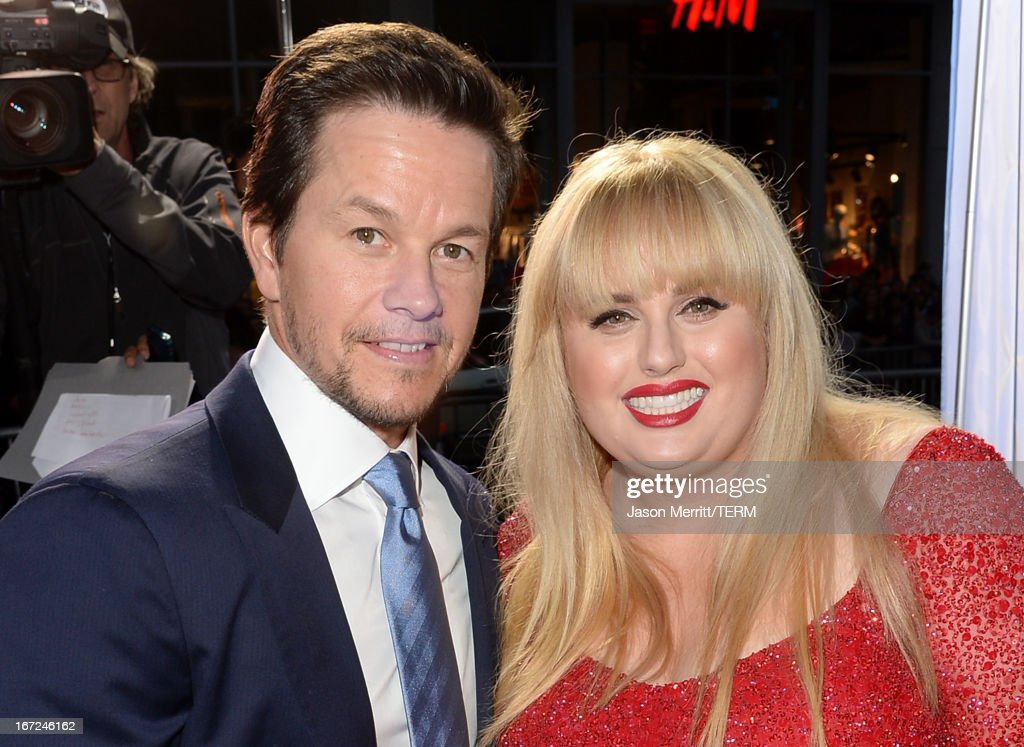 Actors <a gi-track='captionPersonalityLinkClicked' href=/galleries/search?phrase=Mark+Wahlberg&family=editorial&specificpeople=202265 ng-click='$event.stopPropagation()'>Mark Wahlberg</a> and <a gi-track='captionPersonalityLinkClicked' href=/galleries/search?phrase=Rebel+Wilson&family=editorial&specificpeople=5563104 ng-click='$event.stopPropagation()'>Rebel Wilson</a> arrive at the premiere of Paramount Pictures' 'Pain & Gain' at TCL Chinese Theatre on April 22, 2013 in Hollywood, California.