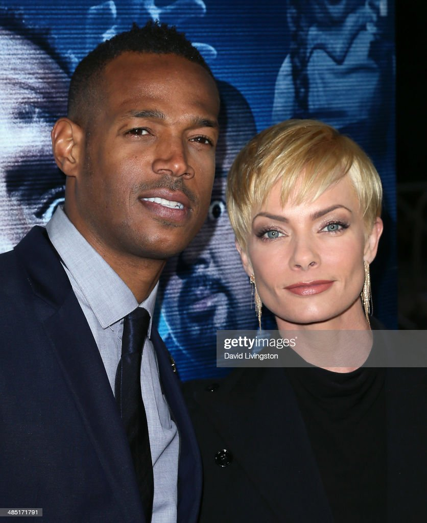 Actors <a gi-track='captionPersonalityLinkClicked' href=/galleries/search?phrase=Marlon+Wayans&family=editorial&specificpeople=203226 ng-click='$event.stopPropagation()'>Marlon Wayans</a> (L) and <a gi-track='captionPersonalityLinkClicked' href=/galleries/search?phrase=Jaime+Pressly&family=editorial&specificpeople=211226 ng-click='$event.stopPropagation()'>Jaime Pressly</a> attend the premiere of Open Road Films' 'A Haunted House 2' at Regal Cinemas L.A. Live on April 16, 2014 in Los Angeles, California.
