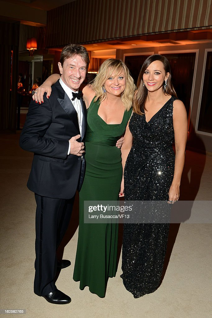Actors <a gi-track='captionPersonalityLinkClicked' href=/galleries/search?phrase=Martin+Short&family=editorial&specificpeople=211569 ng-click='$event.stopPropagation()'>Martin Short</a>, <a gi-track='captionPersonalityLinkClicked' href=/galleries/search?phrase=Amy+Poehler&family=editorial&specificpeople=228430 ng-click='$event.stopPropagation()'>Amy Poehler</a>, and <a gi-track='captionPersonalityLinkClicked' href=/galleries/search?phrase=Rashida+Jones&family=editorial&specificpeople=2133481 ng-click='$event.stopPropagation()'>Rashida Jones</a> attend the 2013 Vanity Fair Oscar Party hosted by Graydon Carter at Sunset Tower on February 24, 2013 in West Hollywood, California.