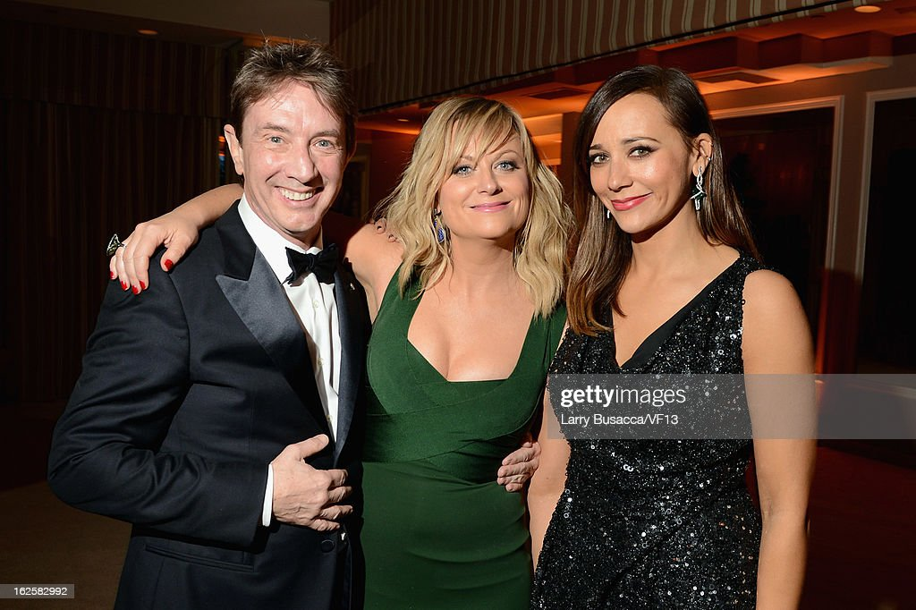 Actors Martin Short, Amy Poehler, and Rashida Jones attend the 2013 Vanity Fair Oscar Party hosted by Graydon Carter at Sunset Tower on February 24, 2013 in West Hollywood, California.