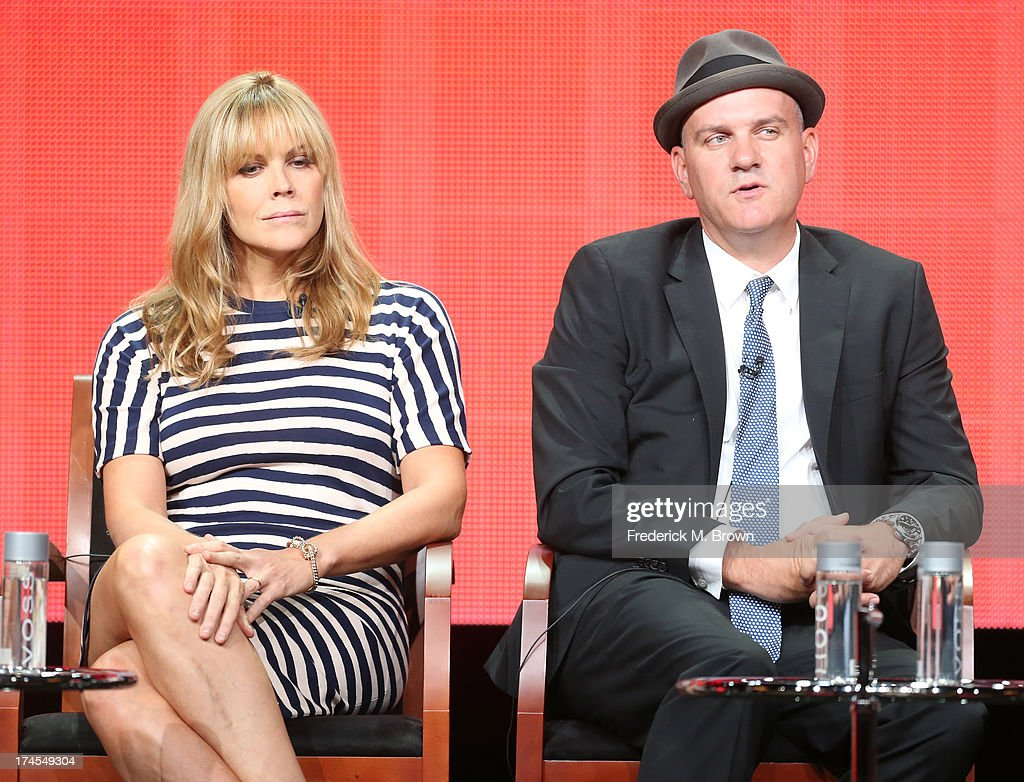 Actors Mary McCormack and Mike O'Malley speak onstage during the 'Welcome to the Family' panel discussion at the NBC portion of the 2013 Summer Television Critics Association tour - Day 4 at the Beverly Hilton Hotel on July 27, 2013 in Beverly Hills, California.