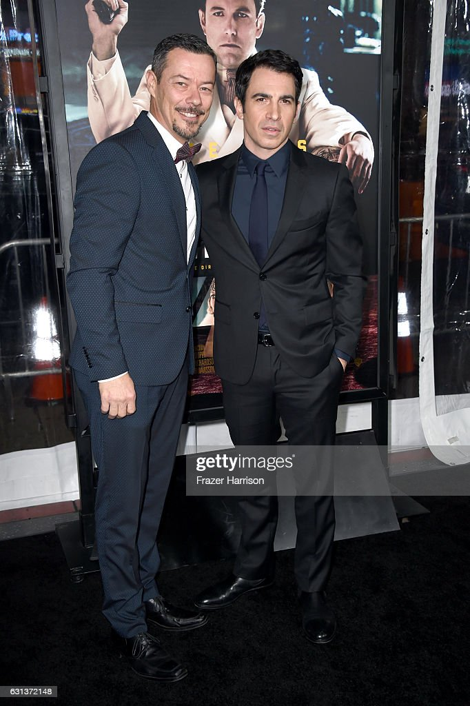 Actors Massi Furlan and Chris Messina attend the premiere of Warner Bros. Pictures' 'Live By Night' at TCL Chinese Theatre on January 9, 2017 in Hollywood, California.