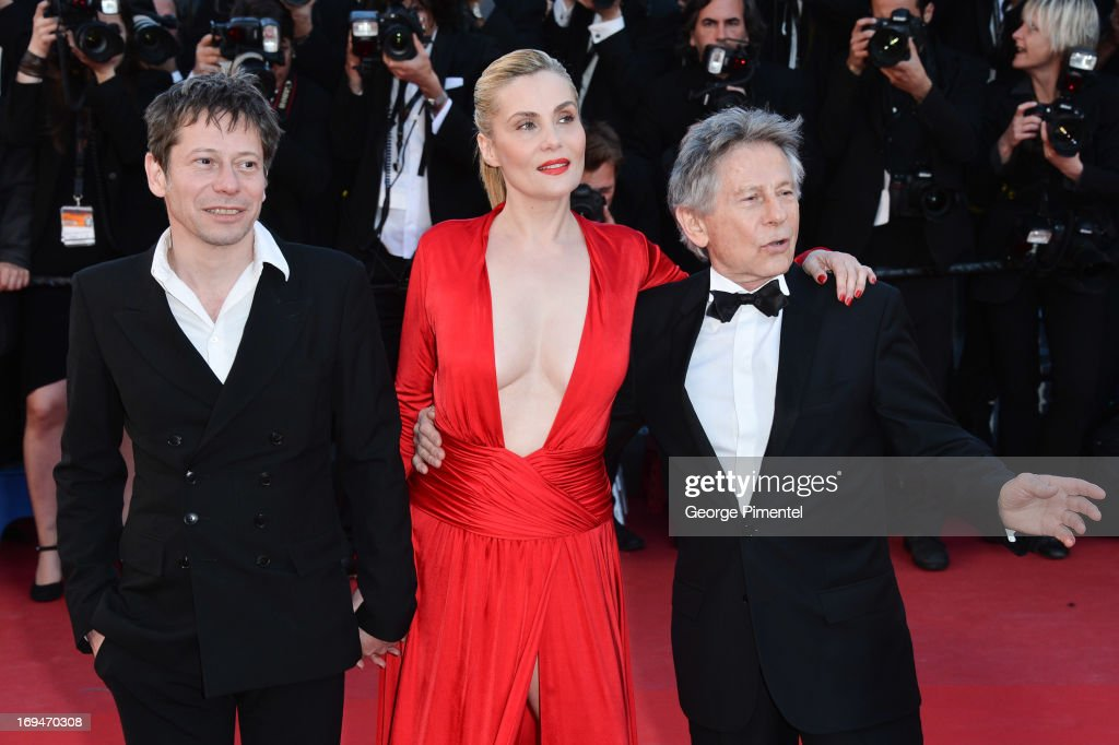 Actors <a gi-track='captionPersonalityLinkClicked' href=/galleries/search?phrase=Mathieu+Amalric&family=editorial&specificpeople=612979 ng-click='$event.stopPropagation()'>Mathieu Amalric</a>, <a gi-track='captionPersonalityLinkClicked' href=/galleries/search?phrase=Emmanuelle+Seigner&family=editorial&specificpeople=240590 ng-click='$event.stopPropagation()'>Emmanuelle Seigner</a> and director <a gi-track='captionPersonalityLinkClicked' href=/galleries/search?phrase=Roman+Polanski&family=editorial&specificpeople=207150 ng-click='$event.stopPropagation()'>Roman Polanski</a> attend the 'La Venus A La Fourrure' premiere during The 66th Annual Cannes Film Festival at Theatre Lumiere on May 25, 2013 in Cannes, France.