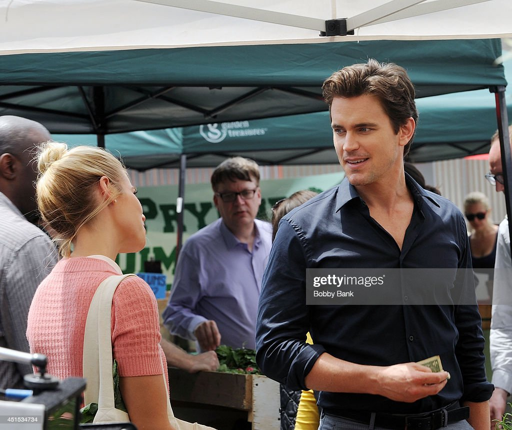 Actors <a gi-track='captionPersonalityLinkClicked' href=/galleries/search?phrase=Matt+Bomer&family=editorial&specificpeople=2960058 ng-click='$event.stopPropagation()'>Matt Bomer</a> and <a gi-track='captionPersonalityLinkClicked' href=/galleries/search?phrase=Laura+Ramsey&family=editorial&specificpeople=649583 ng-click='$event.stopPropagation()'>Laura Ramsey</a> on the set of 'White Collar' on June 30, 2014 in New York City.