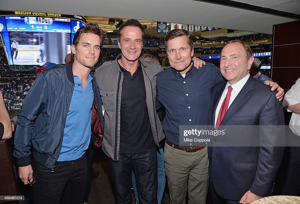 Actors Matt Bomer, Tim DeKay, Stephen B. Burke, and Commissioner of the National Hockey League Gary Bettman attend game four of the 2014 NHL Stanley Cup Final at Madison Square Garden on June 11, 2014 in New York City.