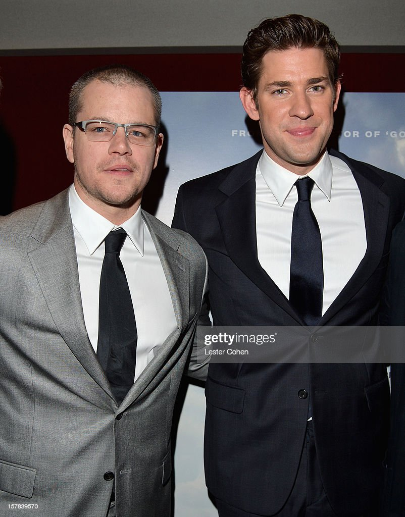 Actors Matt Damon (L) and John Krasinski attend the ''Promised Land' Los Angeles premiere at Directors Guild Of America on December 6, 2012 in Los Angeles, California.
