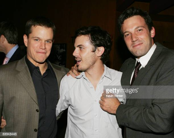 Actors Matt Damon Casey Affleck and Ben Affleck talk at the premiere of Dimension Film's 'The Brothers Grimm' at the Directors Guild Theater on...