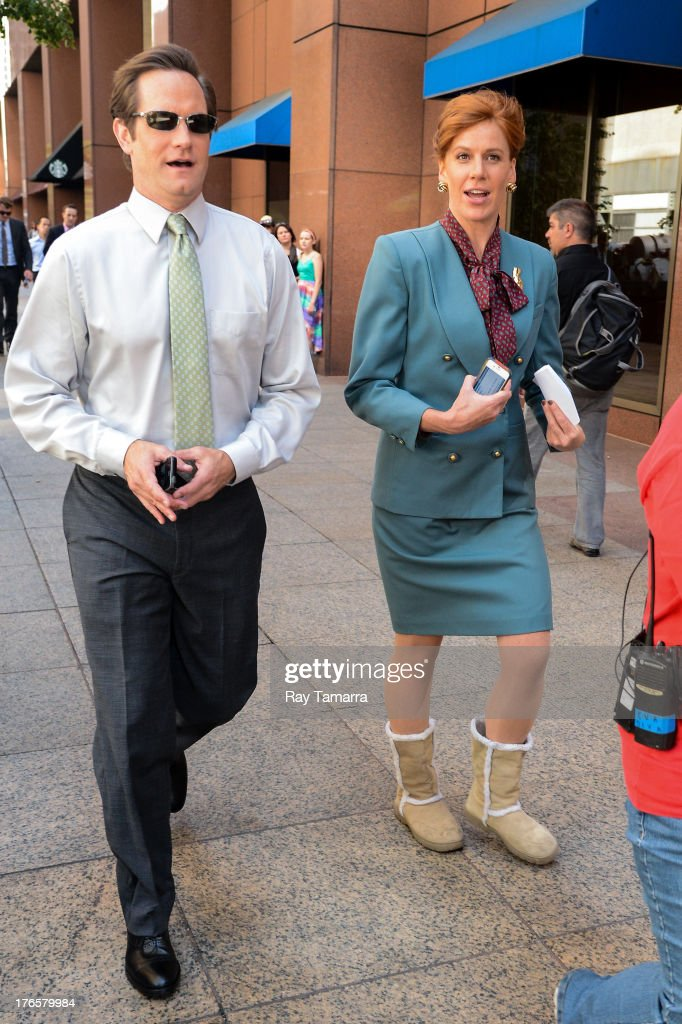 Actors Matt Letscher (L) and Kate Nowlin enter the 'Carrie Diaries' movie set in Midtown Manhattan on August 15, 2013 in New York City.