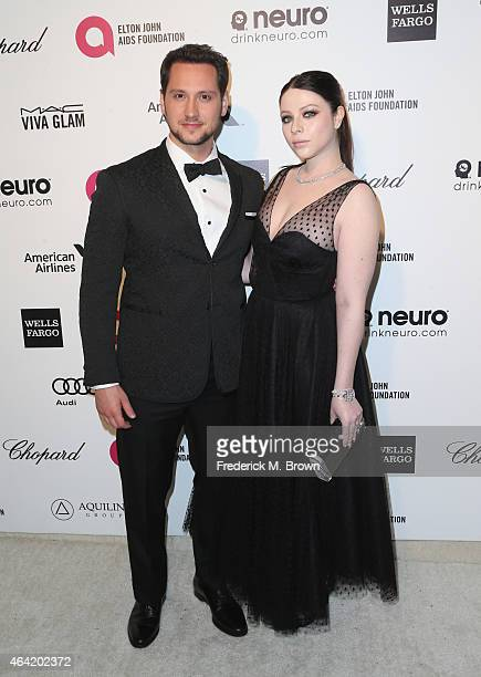 Actors Matt McGorry and Michelle Trachtenberg attend the 23rd Annual Elton John AIDS Foundation's Oscar Viewing Party on February 22 2015 in West...