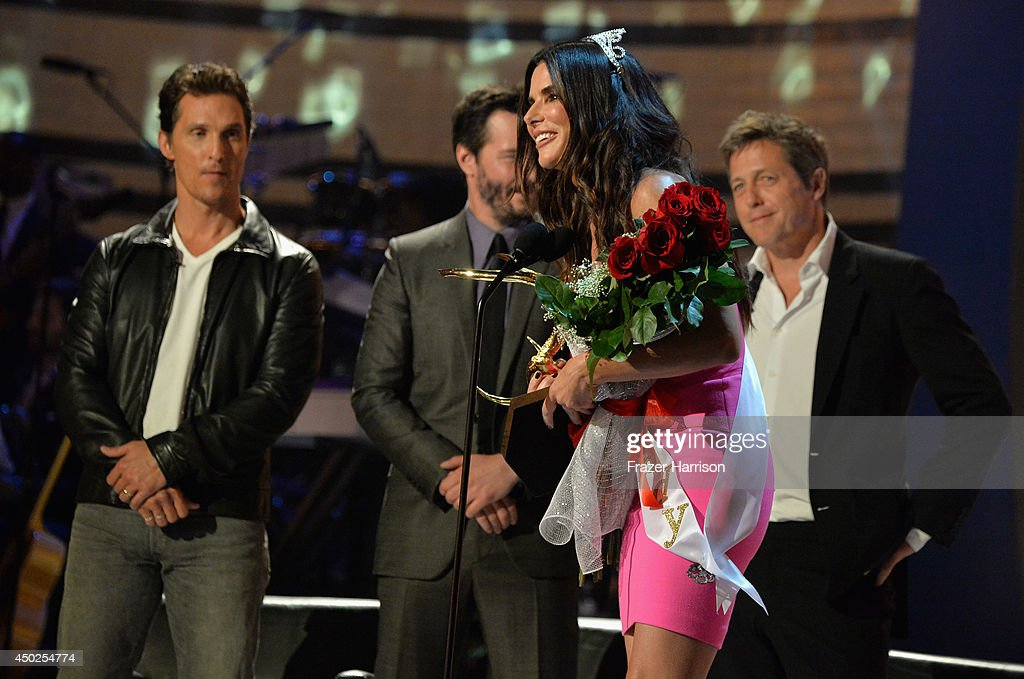 Actors Matthew McConaughey, Keanu Reeves, Hugh Grant, and the Winner of Decade of Hotness Sandra Bullock speak onstage during Spike TV's 'Guys Choice 2014' at Sony Pictures Studios on June 7, 2014 in Culver City, California.