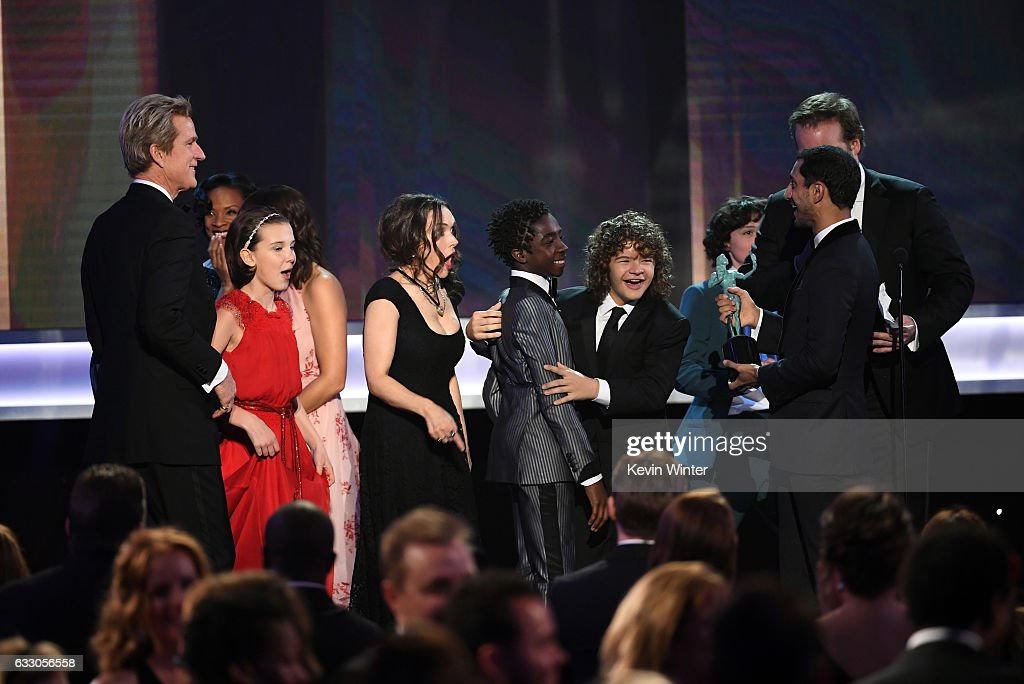 Actors Matthew Modine, Millie Bobby Brown, Winona Ryder, Caleb McLaughlin, Gaten Matarazzo, Finn Wolfhard and David Harbour of 'Stranger Things' accept the Outstanding Performance by an Ensemble in a Drama Series from presenter Riz Ahmed onstage during The 23rd Annual Screen Actors Guild Awards at The Shrine Auditorium on January 29, 2017 in Los Angeles, California. 26592_014