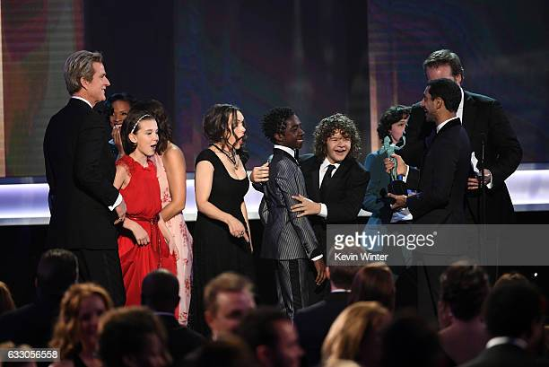 Actors Matthew Modine Millie Bobby Brown Winona Ryder Caleb McLaughlin Gaten Matarazzo Finn Wolfhard and David Harbour of 'Stranger Things' accept...