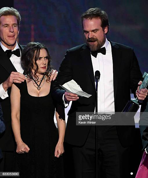 Actors Matthew Modine Winona Ryder and David Harbour of 'Stranger Things' accept Outstanding Performance by an Ensemble in a Drama Series onstage...