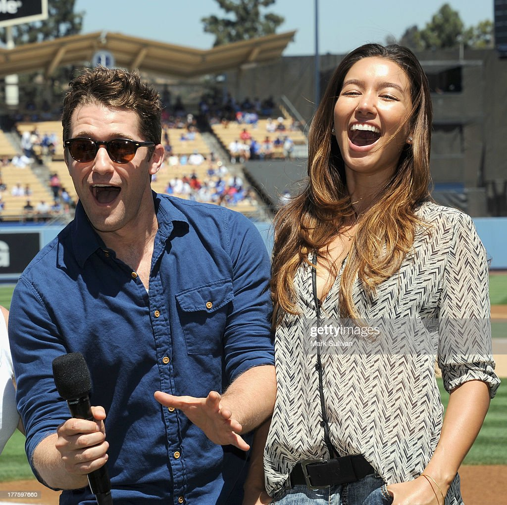 Actors Matthew Morrison and Renee Puente on the field before the game between the Los Angeles Dodgers and the Boston Red Sox at Dodger Stadium on...