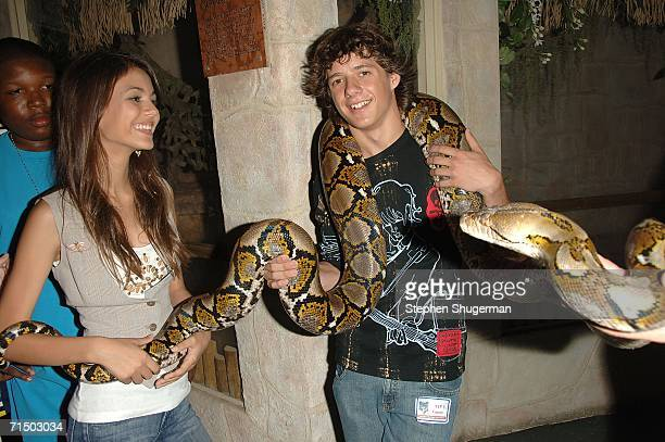 Actors Matthew Underwood and Victoria Justice hold a Anaconda Snake at the After Party forthe DVD Release 'Choose Your Own Adventure The Abominable...