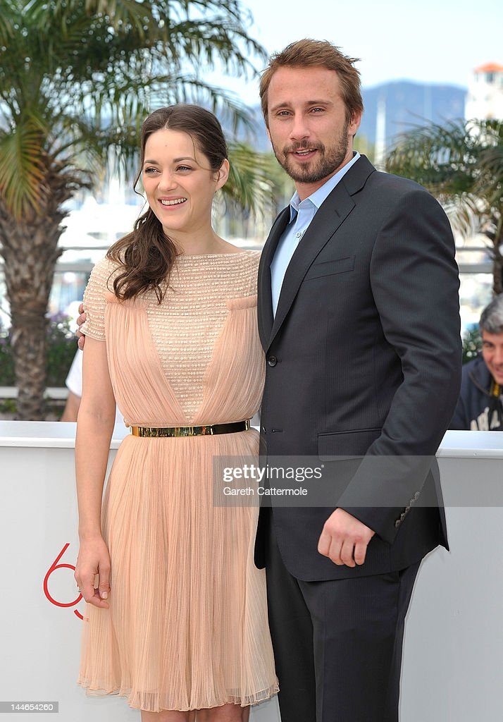 Actors <a gi-track='captionPersonalityLinkClicked' href=/galleries/search?phrase=Matthias+Schoenaerts&family=editorial&specificpeople=6259320 ng-click='$event.stopPropagation()'>Matthias Schoenaerts</a> and <a gi-track='captionPersonalityLinkClicked' href=/galleries/search?phrase=Marion+Cotillard&family=editorial&specificpeople=215303 ng-click='$event.stopPropagation()'>Marion Cotillard</a> pose at the 'De Rouille et D'os' Photocall during the 65th Annual Cannes Film Festival at Palais des Festivals on May 17, 2012 in Cannes, France.