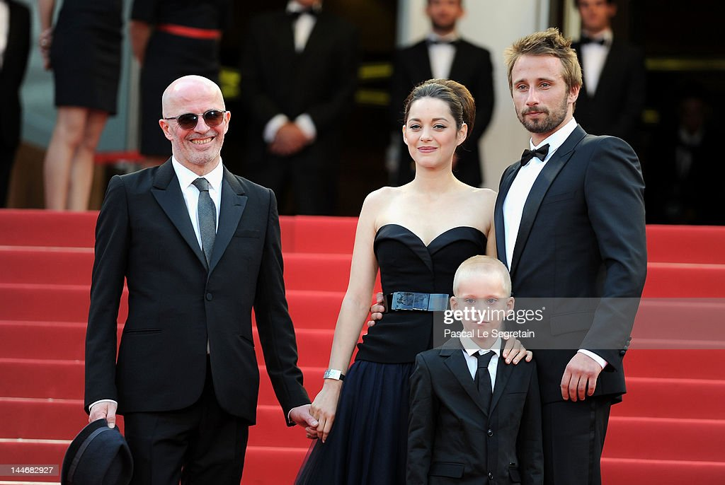 Actors <a gi-track='captionPersonalityLinkClicked' href=/galleries/search?phrase=Matthias+Schoenaerts&family=editorial&specificpeople=6259320 ng-click='$event.stopPropagation()'>Matthias Schoenaerts</a> (R), Armand Verdure, <a gi-track='captionPersonalityLinkClicked' href=/galleries/search?phrase=Marion+Cotillard&family=editorial&specificpeople=215303 ng-click='$event.stopPropagation()'>Marion Cotillard</a> and director <a gi-track='captionPersonalityLinkClicked' href=/galleries/search?phrase=Jacques+Audiard&family=editorial&specificpeople=624567 ng-click='$event.stopPropagation()'>Jacques Audiard</a> (L) attend the 'De Rouille et D'os' Premiere during the 65th Annual Cannes Film Festival at Palais des Festivals on May 17, 2012 in Cannes, France.