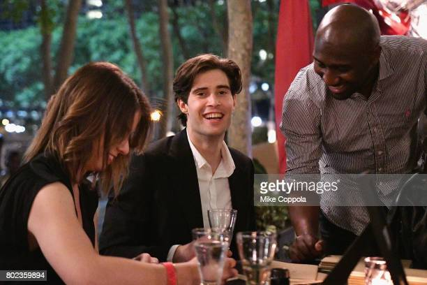 Actors Mattias Inwood and Vauxhall Jermaine visit the calligraphy station during TNT's Season One 'Will' Premiere After Party at Bryant Park on June...