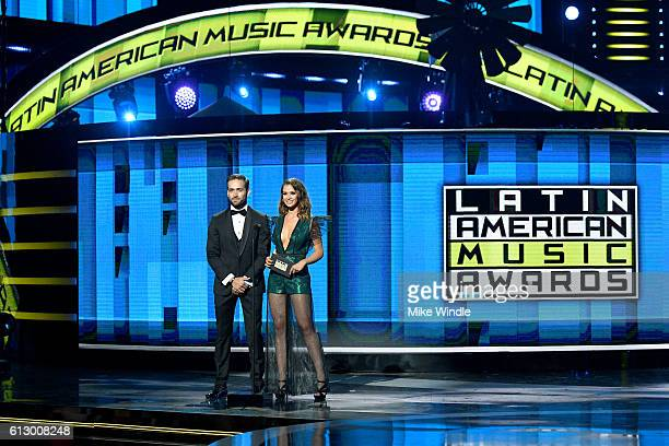 Actors Mauricio Henao and Carolina Miranda speak onstage during the 2016 Latin American Music Awards at Dolby Theatre on October 6 2016 in Hollywood...