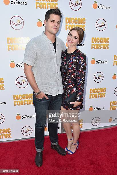Actors Max Carver and Holland Roden attend the premiere of 'Digging for Fire' at The ArcLight Cinemas on August 13 2015 in Hollywood California