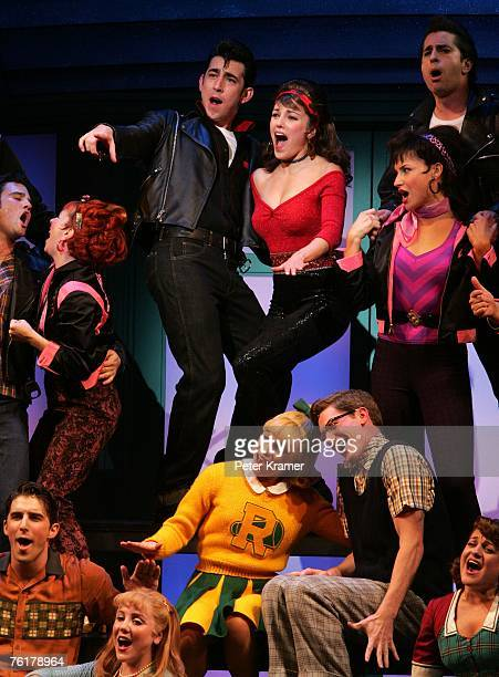 Actors Max Crumm and Laura Osnes perform during the curtain call for the opening night of the Broadway musical 'Grease' on August 19 2007 in New York...