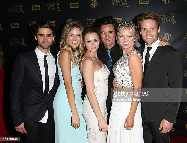 Actors Max Ehrich Melissa Ordway Hunter King Matthew Atkinson Kelli Goss and Lachlan Buchanan pose in the press room during The 42nd Annual Daytime...