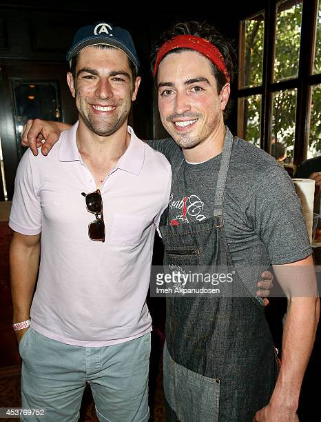 Actors Max Greenfield and Ben Feldman attend Crab Cake 2014 presented by S Pellegrino Samsung Galaxy on August 17 2014 in Los Angeles California