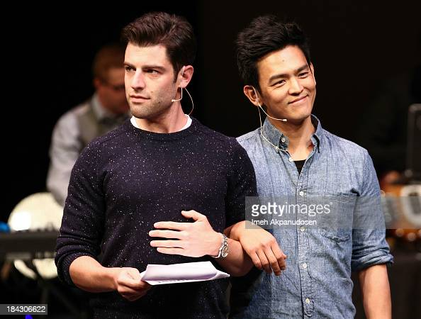 Actors Max Greenfield and John Cho perform onstage at The Young Storytellers Foundation's Annual 'Biggest Show' on October 12 2013 in Santa Monica...