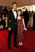 Actors Max Irons and Emily Browning attend the 'Alexander McQueen Savage Beauty' Costume Institute Gala at The Metropolitan Museum of Art on May 2...
