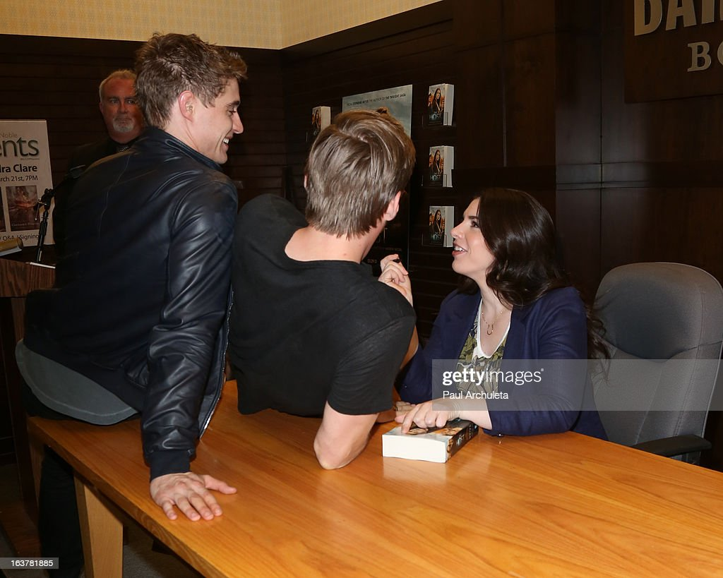 Actors Max Irons, Jake Abel and Author Stephenie Meyer sign copies of 'The Host' at Barnes & Noble bookstore at The Grove on March 15, 2013 in Los Angeles, California.