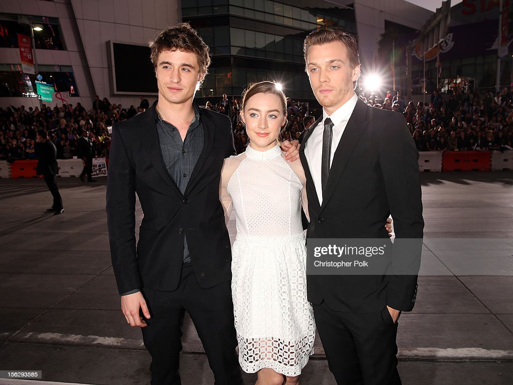Actors Max Irons, Saoirse Ronan, and Jake Abel arrive at the premiere of Summit Entertainment's 'The Twilight Saga: Breaking Dawn - Part 2' at Nokia Theatre L.A. Live on November 12, 2012 in Los Angeles, California.
