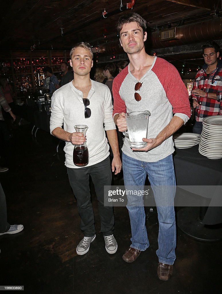 Actors Max Lloyd-Jones (L) and Corey Sevier attend PATH's 4th Annual Thanksgiving Meal at Pink Taco on November 22, 2012 in Los Angeles, California.