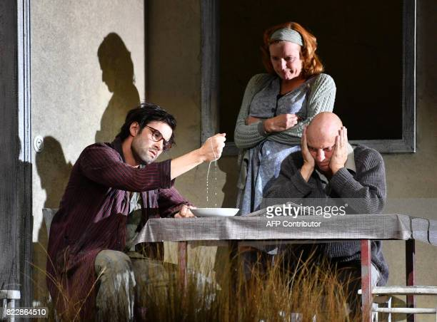 Actors Max Simonischek Nina Petri Pierre Siegenthaler perform in the rehearsal of Harold Pinter's 'Die Geburtstagsfeier' in Salzburg on July 25 2017...