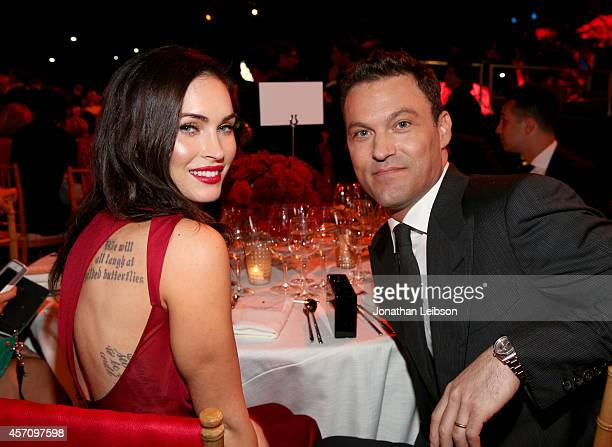 Actors Megan Fox and Brian Austin Green attend Ferrari Celebrates 60 Years In America on October 11 2014 in Los Angeles California