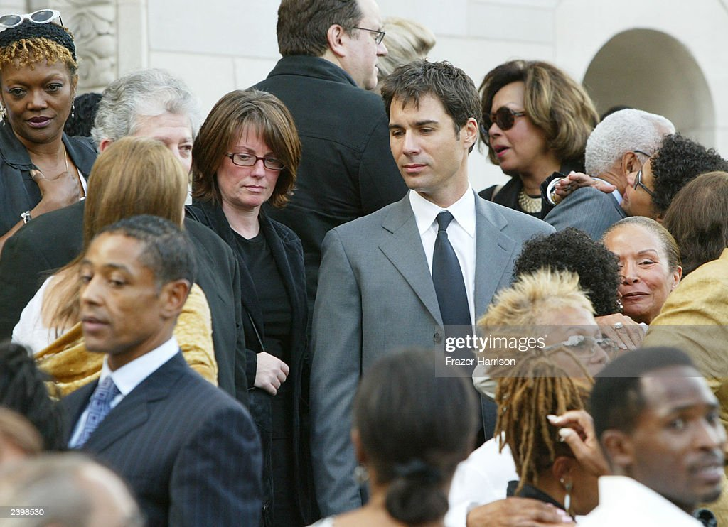 Actors Megan Mullally and Eric McCormack attend the memorial service at Saint Monica's Catholic Church held for actor/dancer Gregory Hines on August 13, 2003 in Santa Monica, California.