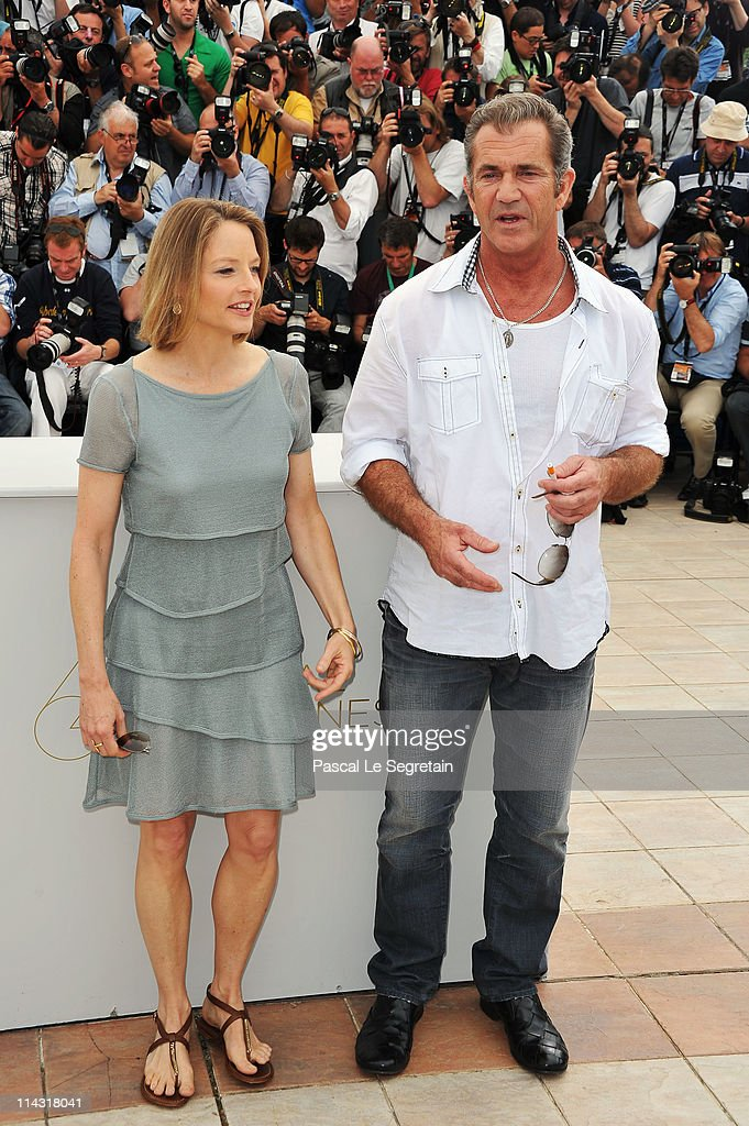 Actors Mel Gibson (R) and <a gi-track='captionPersonalityLinkClicked' href=/galleries/search?phrase=Jodie+Foster&family=editorial&specificpeople=204488 ng-click='$event.stopPropagation()'>Jodie Foster</a> attend 'The Beaver' photocall at the Palais des Festivals during the 64th Cannes Film Festival on May 18, 2011 in Cannes, France.