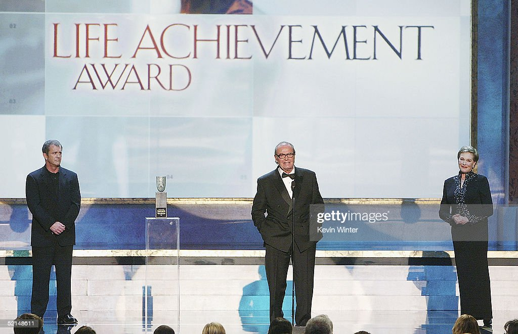 Actors Mel Gibson (L) and Julie Andrews (R) present the Life Achievemant Award to <a gi-track='captionPersonalityLinkClicked' href=/galleries/search?phrase=James+Garner&family=editorial&specificpeople=206254 ng-click='$event.stopPropagation()'>James Garner</a> at the 11th Annual Screen Actors Guild Awards show at the Shrine Auditorium on February 5, 2005 in Los Angeles, California.