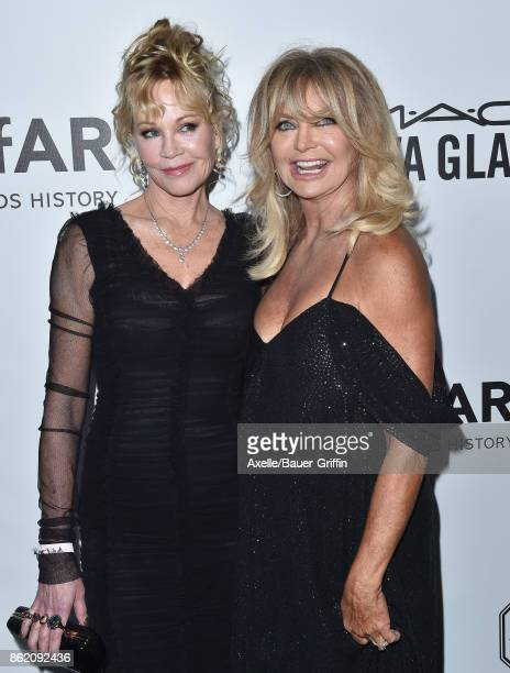 Actors Melanie Griffith and Goldie Hawn arrive at amfAR Los Angeles 2017 at Ron Burkle's Green Acres Estate on October 13 2017 in Beverly Hills...