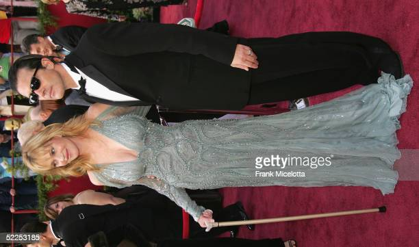 Actors Melanie Griffith and husband Antonio Banderas arrive the 77th Annual Academy Awards at the Kodak Theater on February 27 2005 in Hollywood...