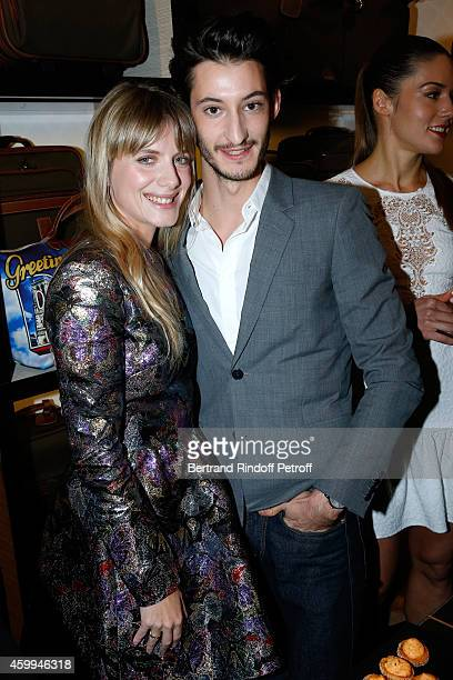 Actors Melanie Laurent and Pierre Niney attend the Longchamp Elysees 'Lights On Party' Boutique Launch on December 4 2014 in Paris France