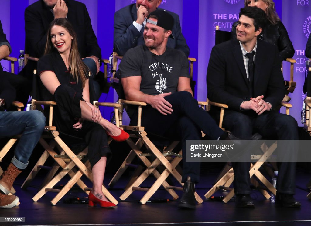 Actors Melissa Benoist, Stephen Amell and Brandon Routh appear on stage at The Paley Center for Media's 34th Annual PaleyFest Los Angeles presentation of The CW's Heroes & Aliens at Dolby Theatre on March 18, 2017 in Hollywood, California.