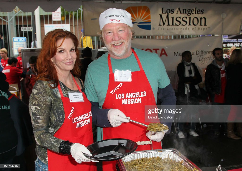Actors Melissa Gilbert (L) and Timothy Busfield attend the Los Angeles Mission's Christmas Eve for the homeless at the Los Angeles Mission on December 24, 2012 in Los Angeles, California.