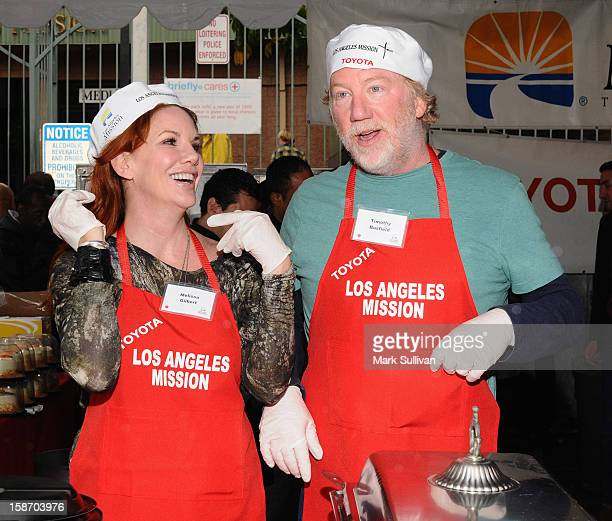 Actors Melissa Gilbert and Timothy Busfield serve food during the Los Angeles Mission Christmas Eve meal for the homeless at Los Angeles Mission on...