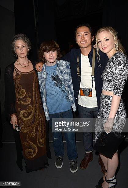 Actors Melissa McBride Chandler Riggs Steven Yeun and Emily Kinney attend AMC's 'The Walking Dead' panel during ComicCon International 2014 at San...