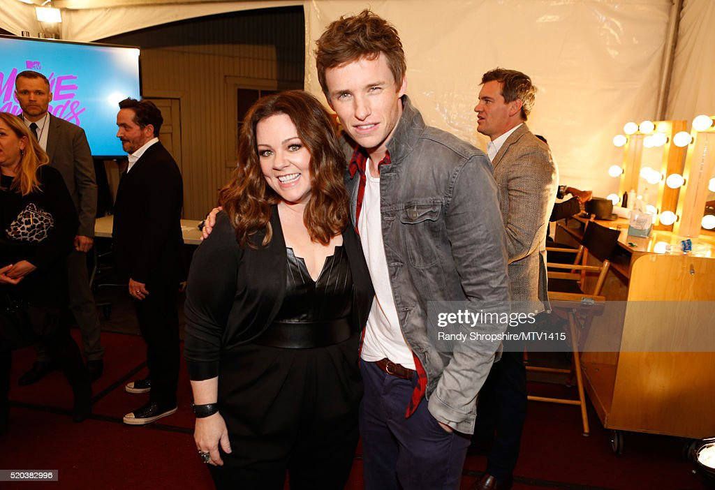 Actors Melissa McCarthy (L) and Eddie Redmayne pose backstage at the 2016 MTV Movie Awards at Warner Bros. Studios on April 9, 2016 in Burbank, California. MTV Movie Awards airs April 10, 2016 at 8pm ET/PT.