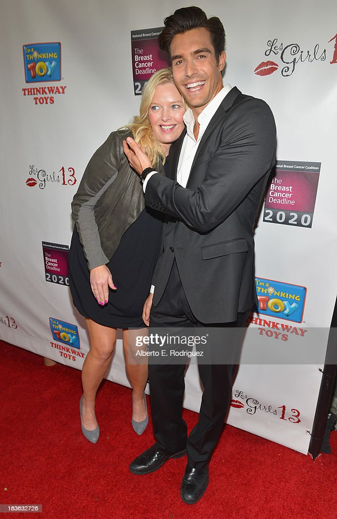 Actors Melissa Peterman and Peter Porte attends The National Breast Cancer Coalition Fund presents The 13th Annual Les Girls at the Avalon on October 7, 2013 in Hollywood, California.