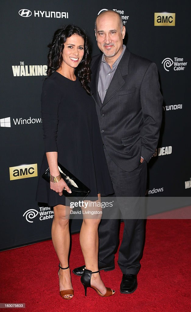 Actors Melissa Ponzio (L) and Kenny Alfonso attend the premiere of AMC's 'The Walking Dead' 4th Season at Universal CityWalk on October 3, 2013 in Universal City, California.