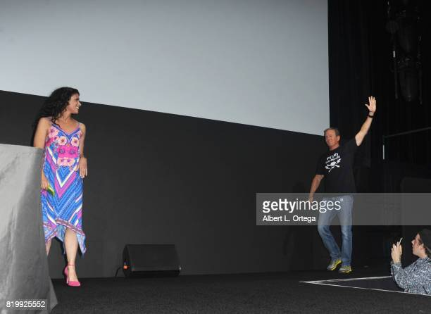 Actors Melissa Ponzio and Linden Ashby walk onstage at the 'Teen Wolf' panel during ComicCon International 2017 at San Diego Convention Center on...