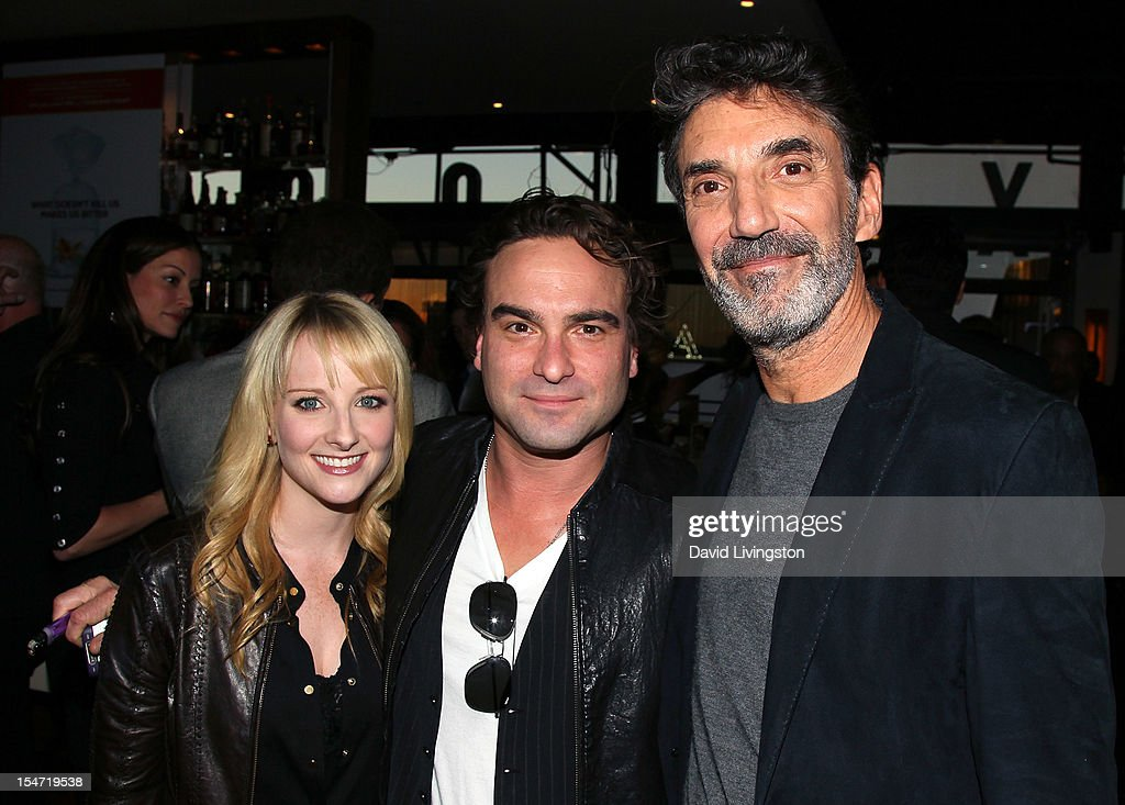 Actors Melissa Rauch and Johnny Galecki and writer Chuck Lorre attend a reception to celebrate the release of Lorre's 'What Doesn't Kill Us Makes Us Bitter' at Mixology101 & Planet Dailies on October 24, 2012 in Los Angeles, California.